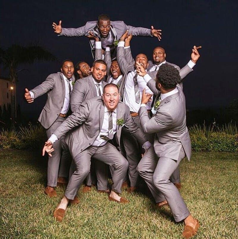 NFL's Kam Chancellor in gray groom wedding suit