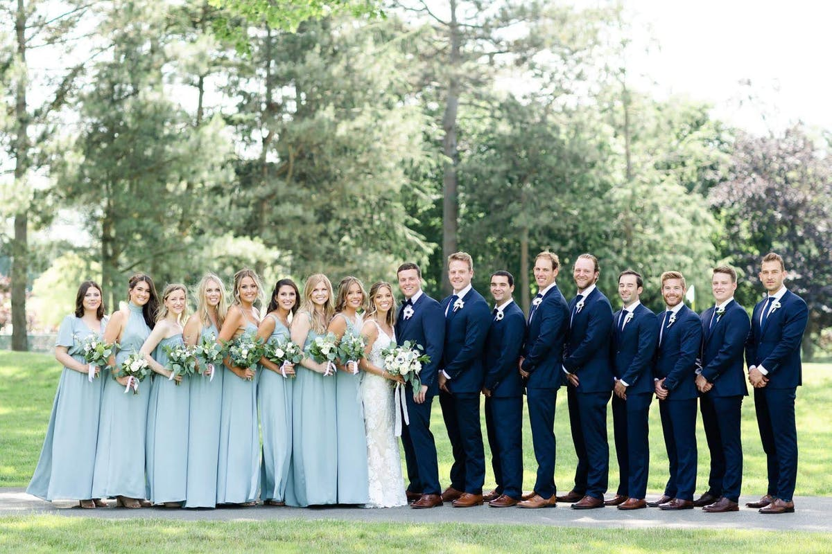 Tips on selecting the right blue suit color for your wedding party based on your bridesmaid dress