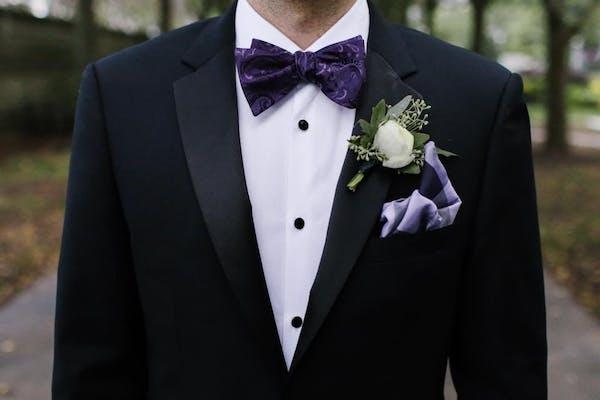 groom in wedding tuxedo jacket