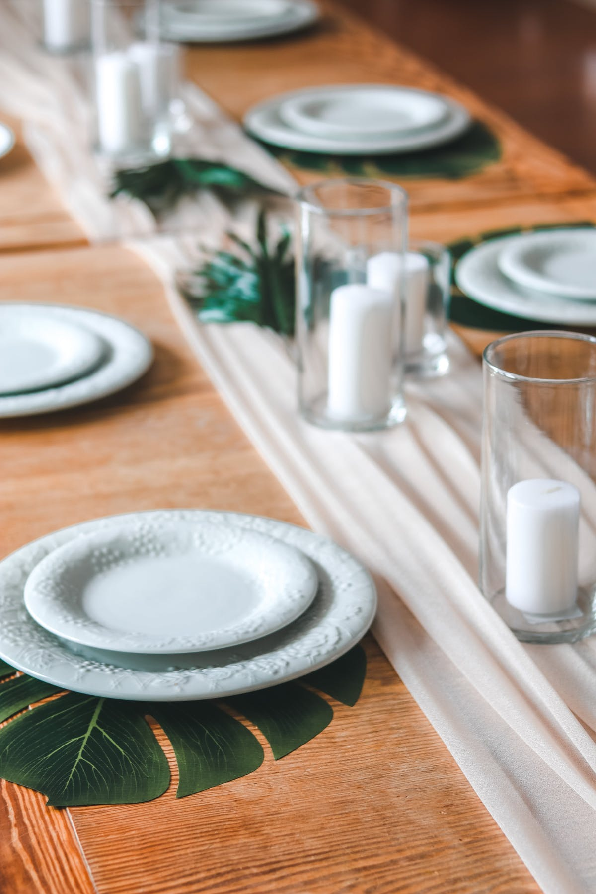 Custom tropical table setting with monesterra leaves and candles