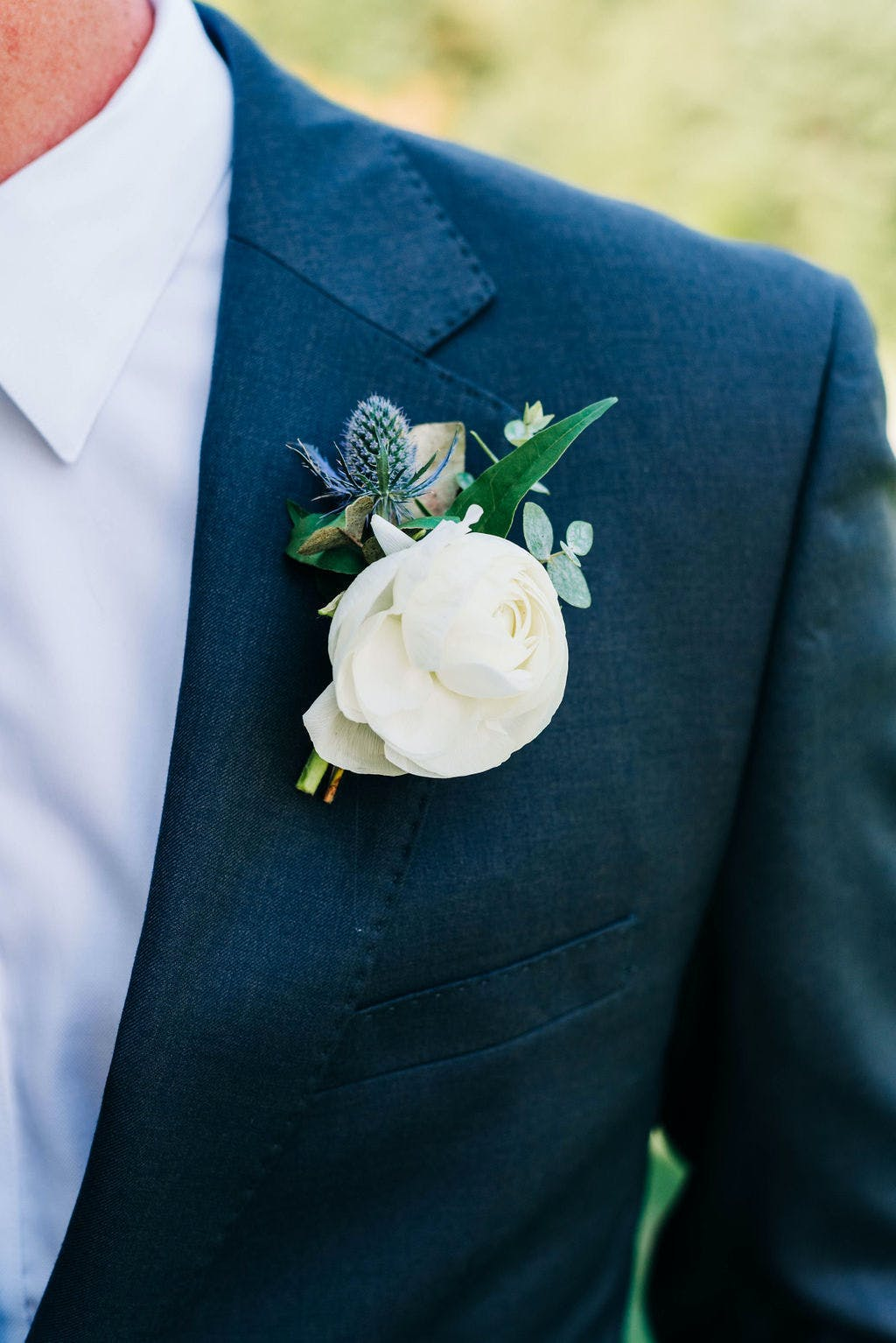 How to place and pin your wedding boutonniere for men.