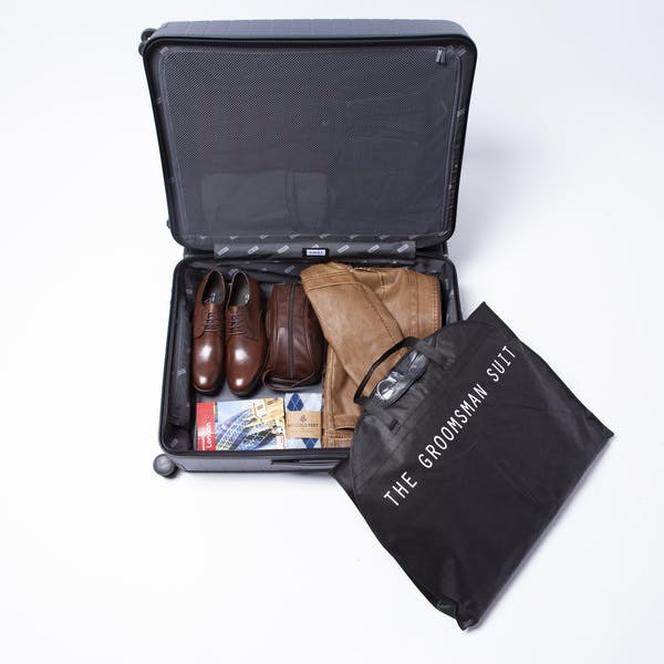 Groomsman Guide: How To Fold A Suit In A Suitcase