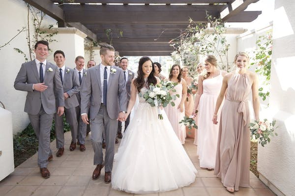 Grey suits and brown soes are a classic choice for weddings.