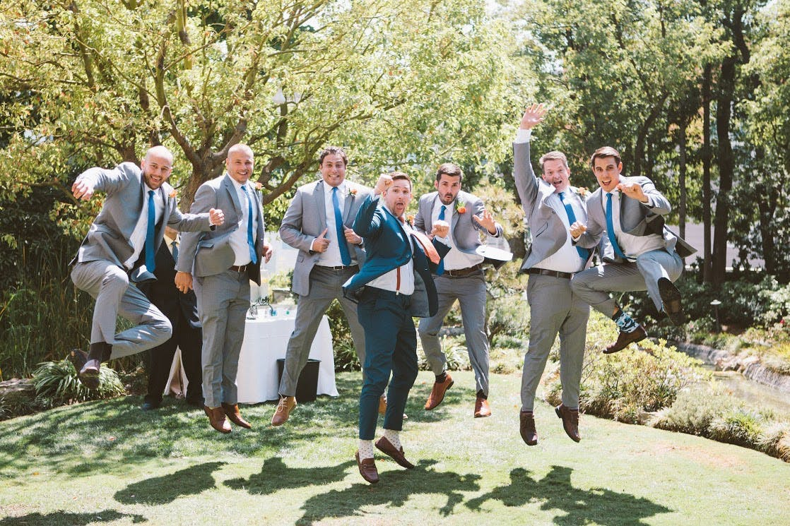 groomsmen in gray suits and brown shoes