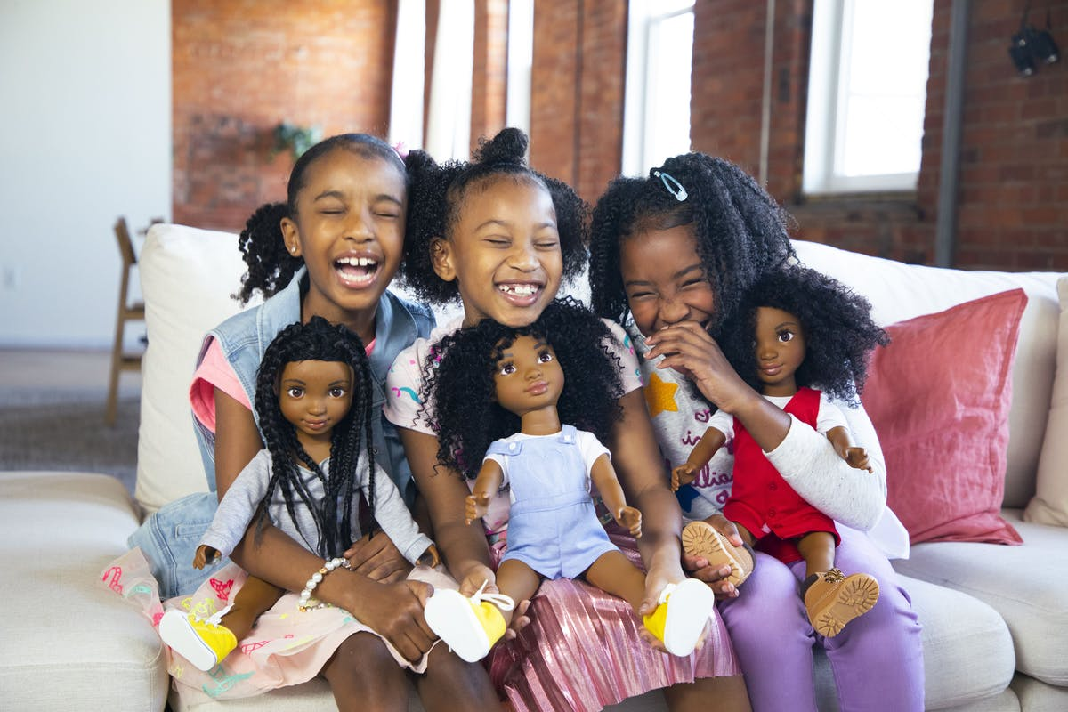 Young girls with natural curls and their Healthy Roots Dolls