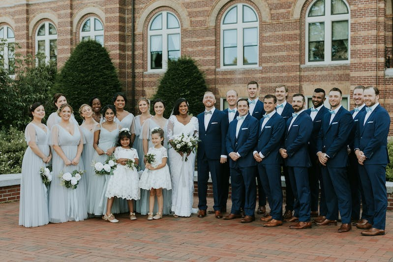 spring wedding with light gray bridesmaids dresses and navy groomsmen suits