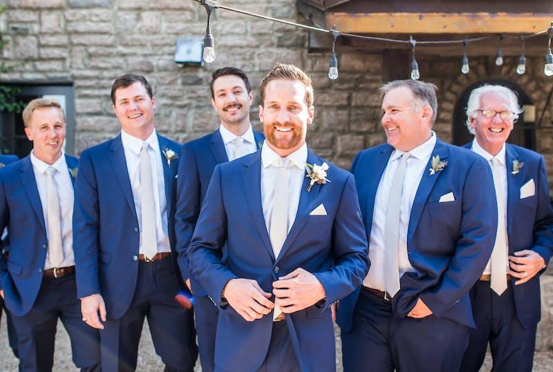 Groomsmen in bright blue wedding suits for men