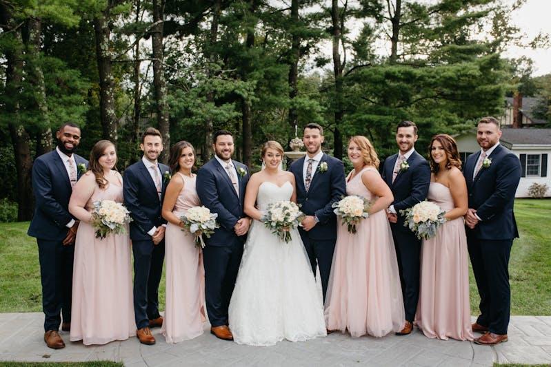 Groom in navy blue wedding suit