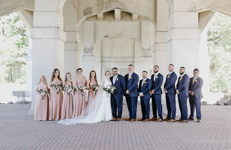 Wedding party in Navy Suits & Mauve Birdy Grey Bridesmaids Dresses