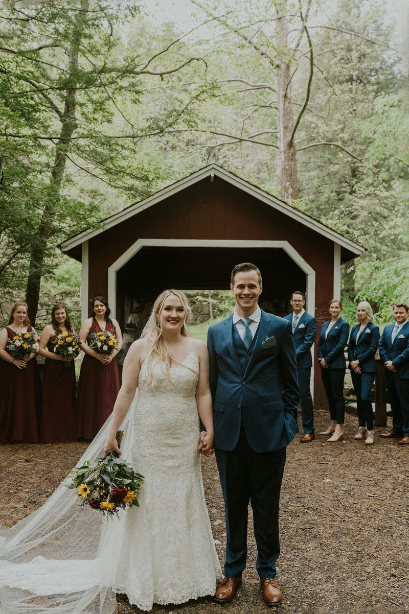 Rustic Wedding with the entire wedding party in coordinating suits
