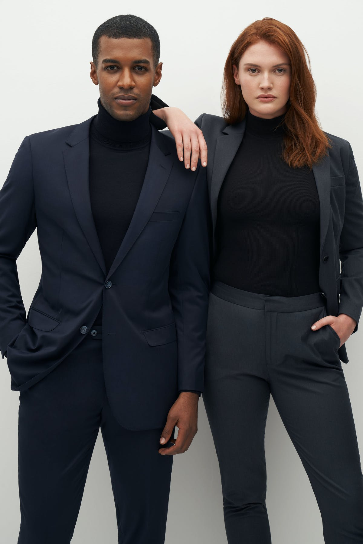turtlenecks and suits