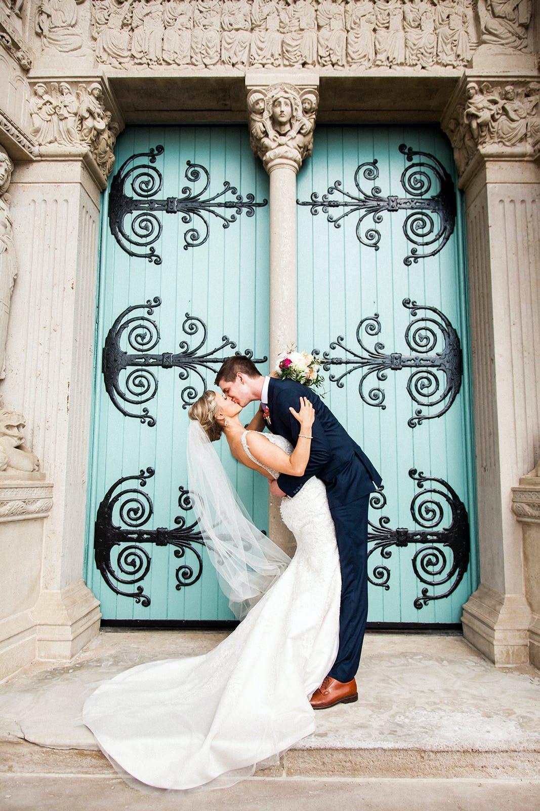 Groom in navy blue wedding suit for men