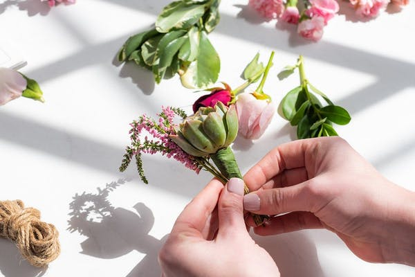 Supplies you need to make your own DIY wedding boutonniere for groomsmen.