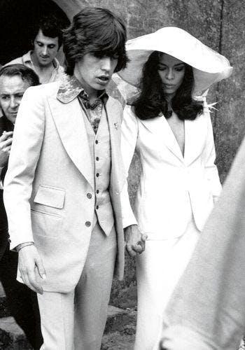 history of women's wedding suits
