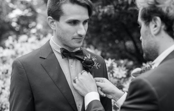 two grooms black tie wedding style
