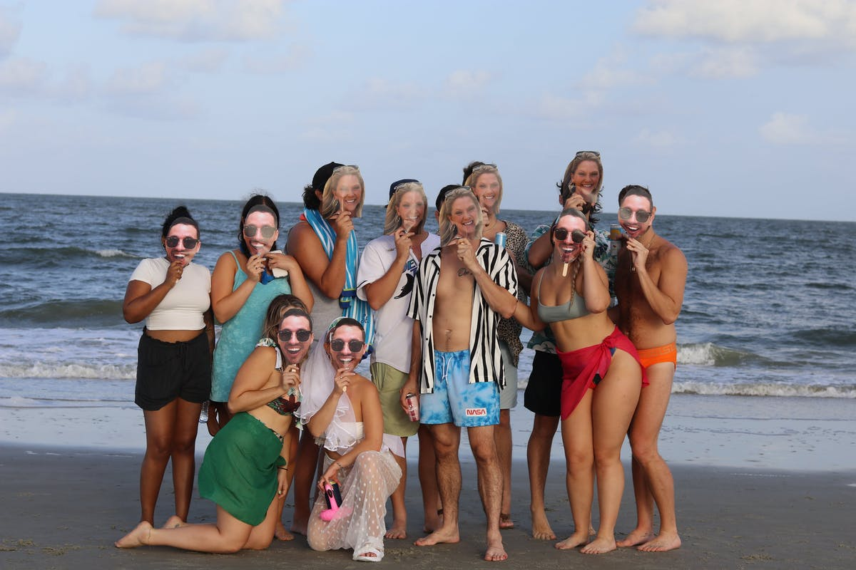 wedding party at their mix gendered bacherlorx party at the beach in Tybee Island, Ga