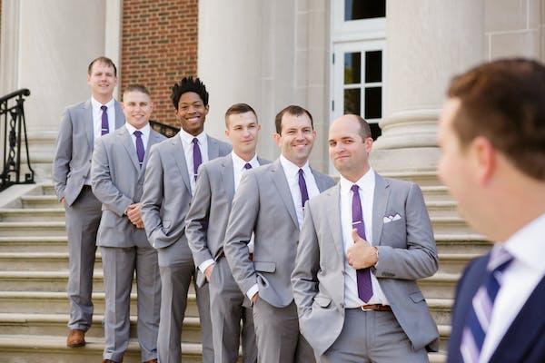 Groomsmen in grey wedding suits