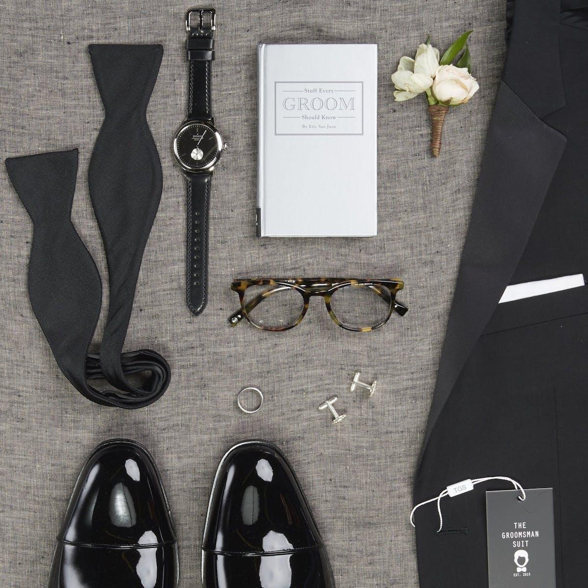 Wedding Planning Checklist for grooms to get groomsmen suited up in wedding suits for men.